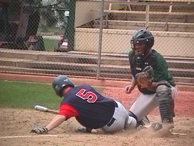 Jason Florea slides into home